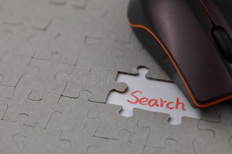 A typical jigsaw puzzle with search. A typical jigsaw puzzle with a gap and search. The last piece of jigsaw puzzle concept for solution and completion royalty free stock photos