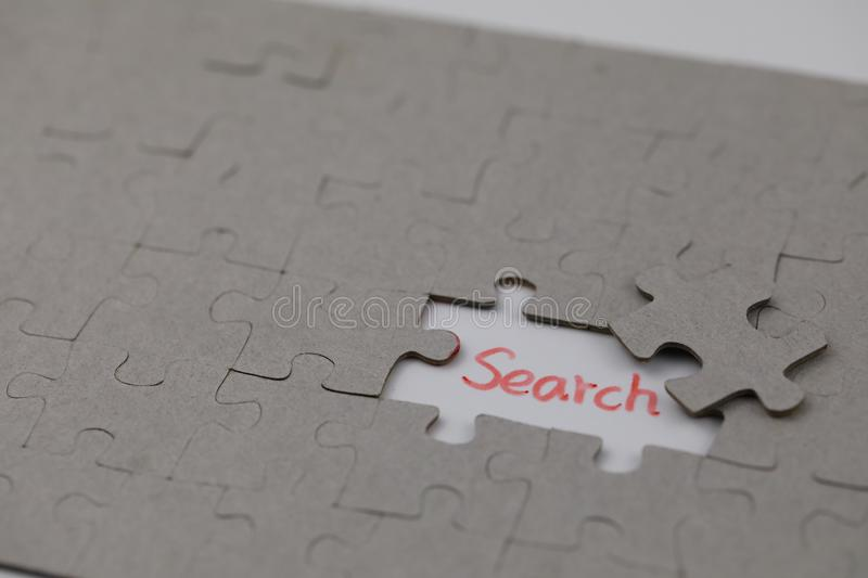A typical jigsaw puzzle with search. A typical jigsaw puzzle with a gap and search. The last piece of jigsaw puzzle concept for solution and completion royalty free stock image