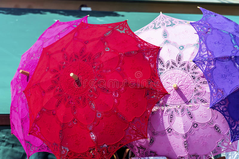 Typical lacy parasols for women on the counter street vendors of souvenirs in Venice, Italy stock photos