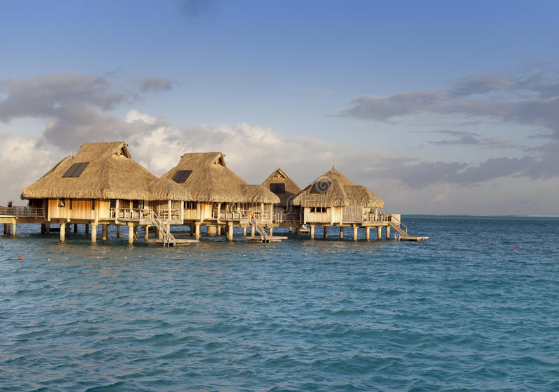 Download Typical Landscape Of Tropical Islands   Huts, Wooden Houses Over  Water Stock Photo