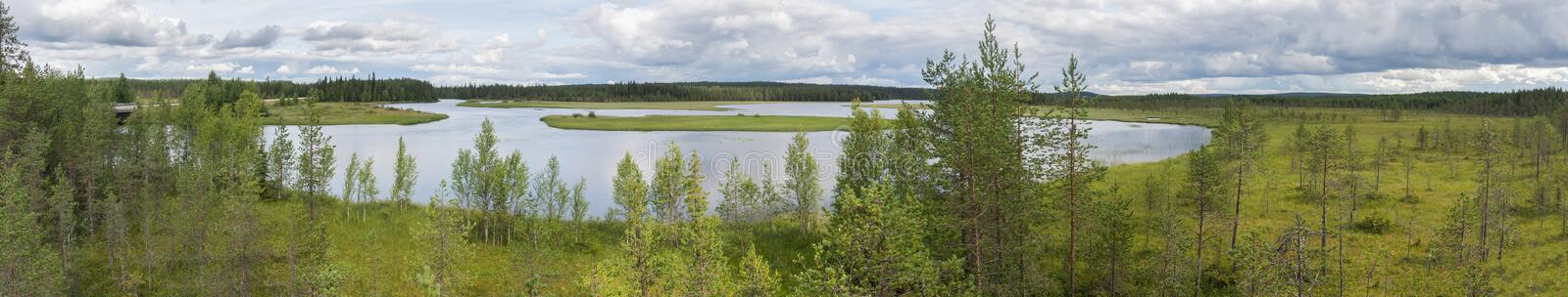 Characteristic landscape of the tundra, lake and vegetation, Fin. Typical landscape of the tundra, lake and vegetation, Finland stock photo