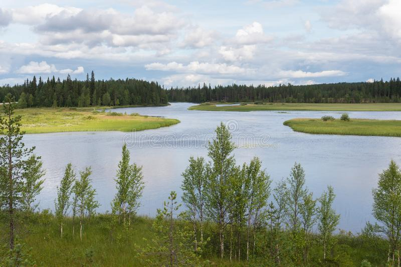 Characteristic landscape of the tundra, lake and vegetation, Fin. Typical landscape of the tundra, lake and vegetation, Finland royalty free stock image