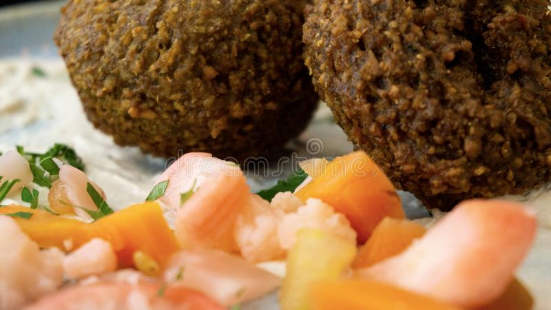 Typical Lebanese dish with falafel and vegetables stock photography