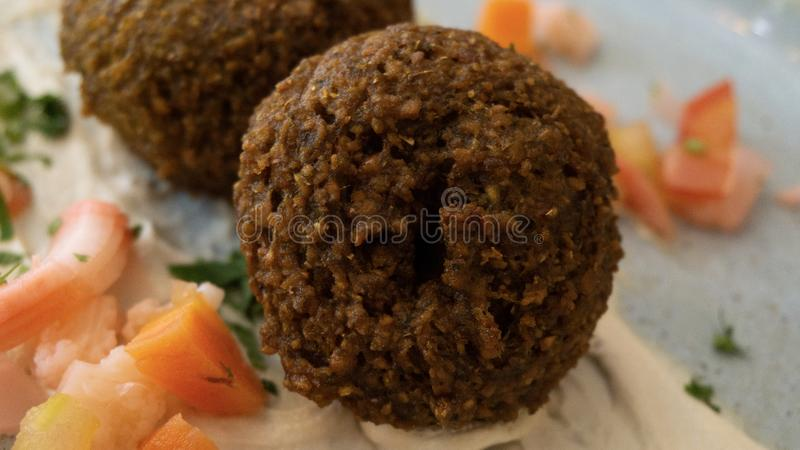 Typical Lebanese dish with falafel and vegetables stock photos