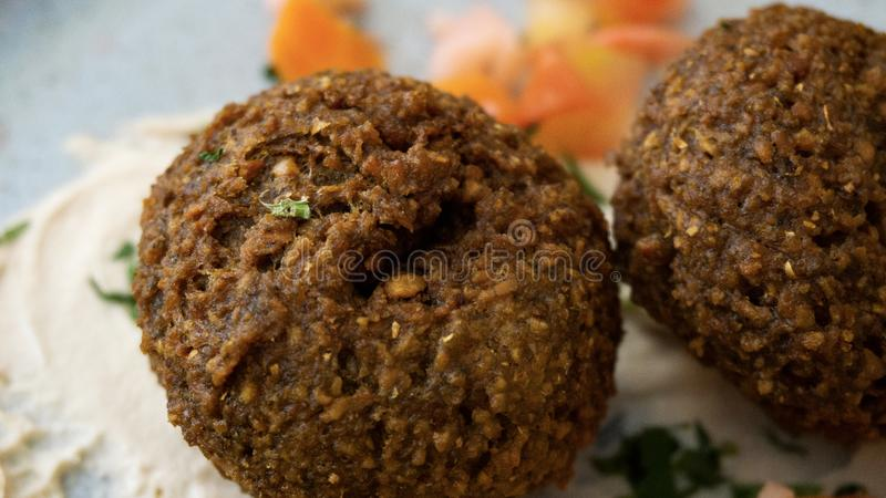 Typical Lebanese dish with falafel and vegetables stock photo