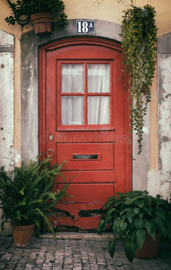 Typical Lisbon Old Door. Typical Lisbon old red door decorated with pots of plants in Bica Neighborhood stock photo
