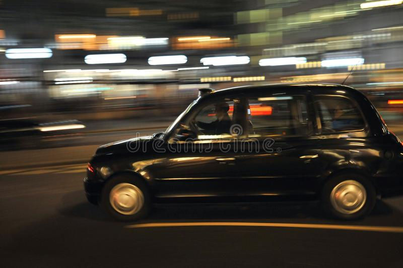 Typical London taxi on the streets of England`s capital. Taking the typical London taxi on the streets of England`s capital in 2018 stock photo