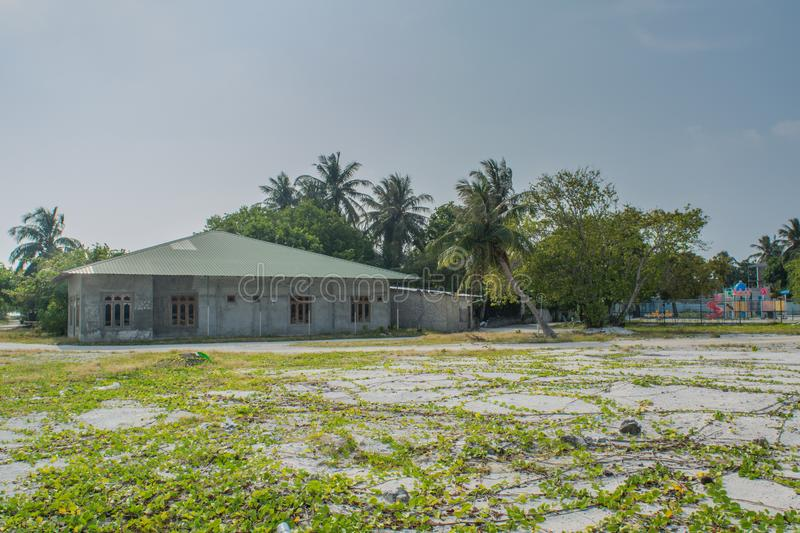 Typical maldivian house located in the village at the tropical island Fenfushi. In Maldives stock photos