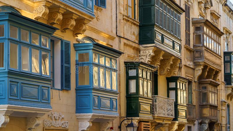 Typical Maltese covered balconies in Valetta, Malta stock photography