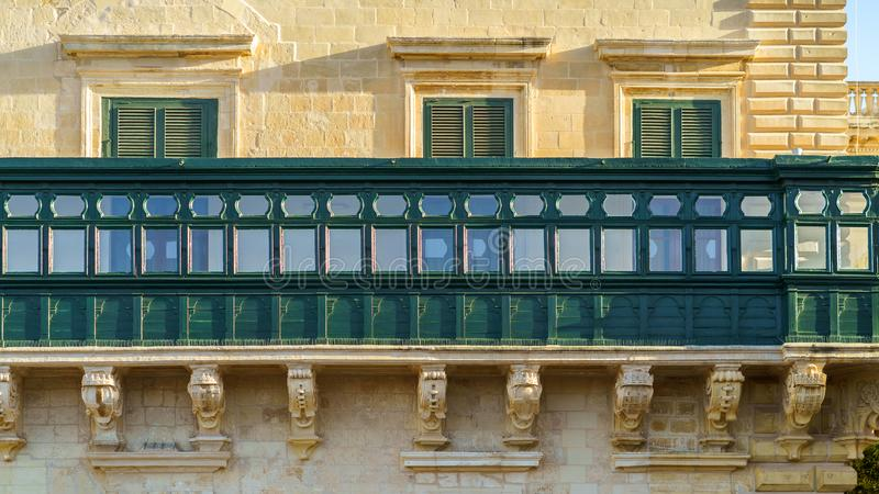 Typical Maltese covered balconies in Valetta, Malta royalty free stock photo