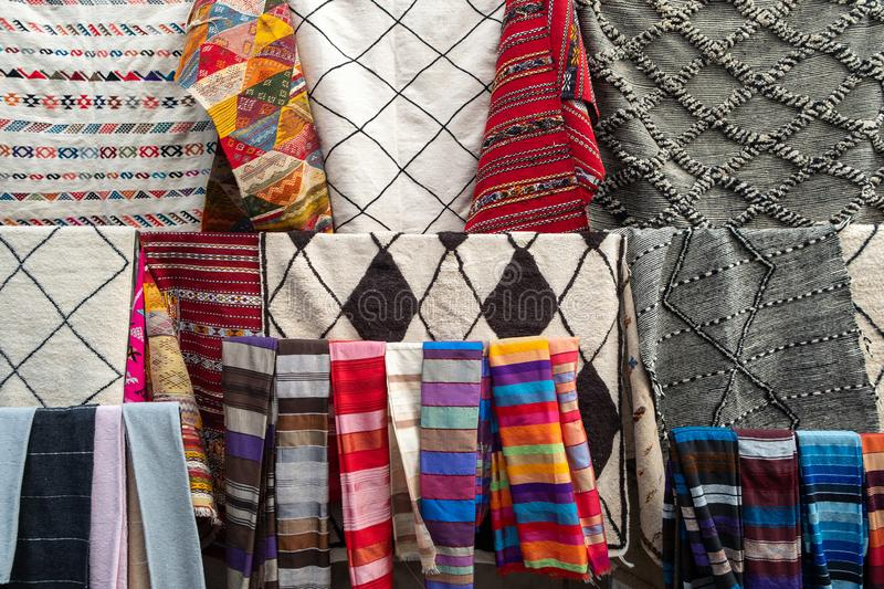 A typical market stall selling a range of clothing and trinkets to tourists in Marrakech stock photo