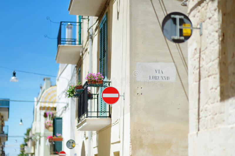 Typical medieval narrow street in beautiful town of Conversano stock image