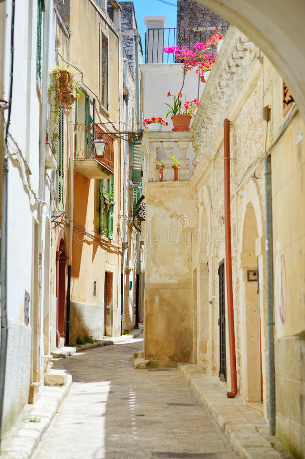 Typical medieval narrow street in beautiful town of Conversano stock photos