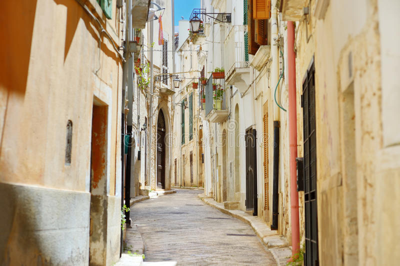 Typical medieval narrow street in beautiful town of Conversano royalty free stock photo