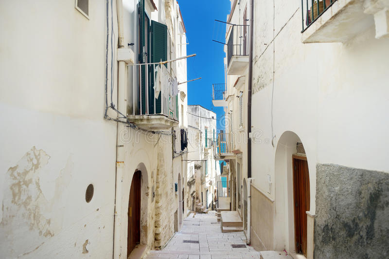 Typical medieval narrow street in beautiful town of Vieste royalty free stock photos