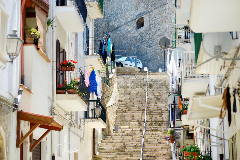 Typical medieval narrow street in beautiful town of Vieste royalty free stock image