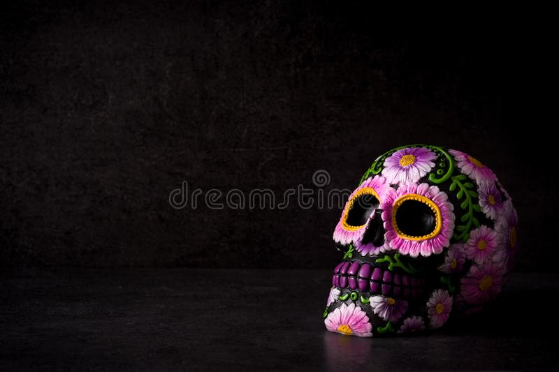 Typical Mexican skull painted on black background. Dia de los muertos. stock image