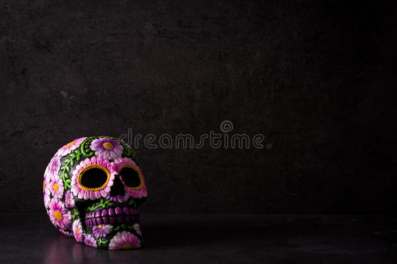 Typical Mexican skull painted on black background. Dia de los muertos. royalty free stock images