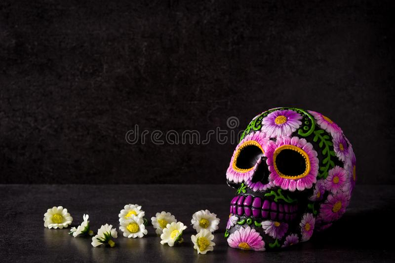 Typical Mexican skull painted on black background. Dia de los muertos. royalty free stock image