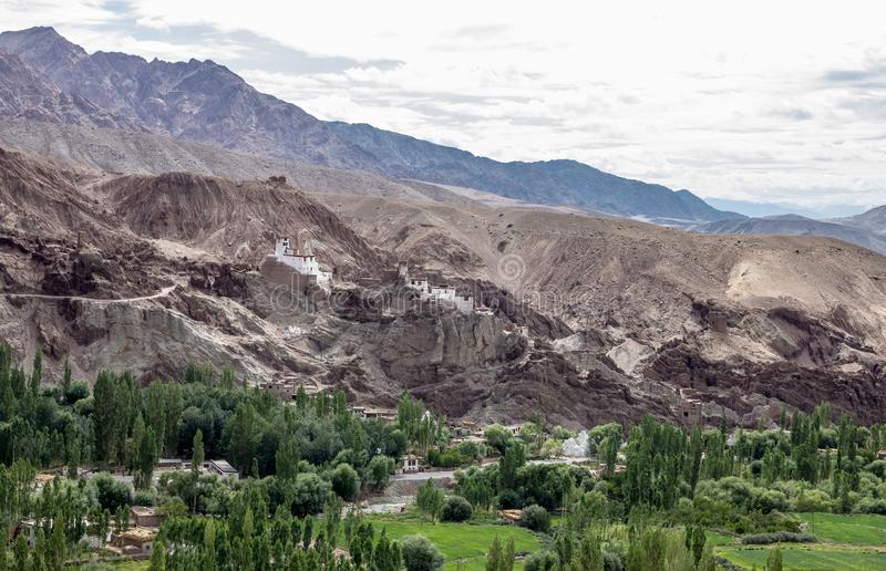 White buildings of Basgo Fort and Buddhist Monastery, Northern I. Typical of monasteries in Ladakh, Basgo Fort was built on top of craggy cliffs. There is a stock photography