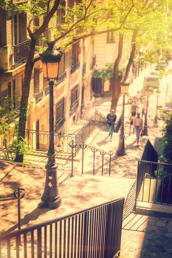 Typical Montmartre staircase and old street lamp, golden sunny light in Paris France royalty free stock image