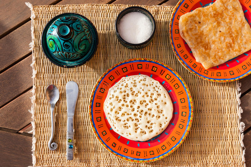 Typical moroccan breakfast. With Beghrir and M'semmen (tender Moroccan pancakes made from semolina flour stock image