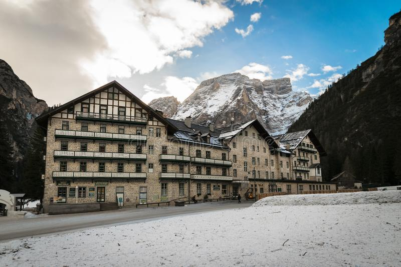 Typical mountain architecture and snowy mountain range in the background stock photos