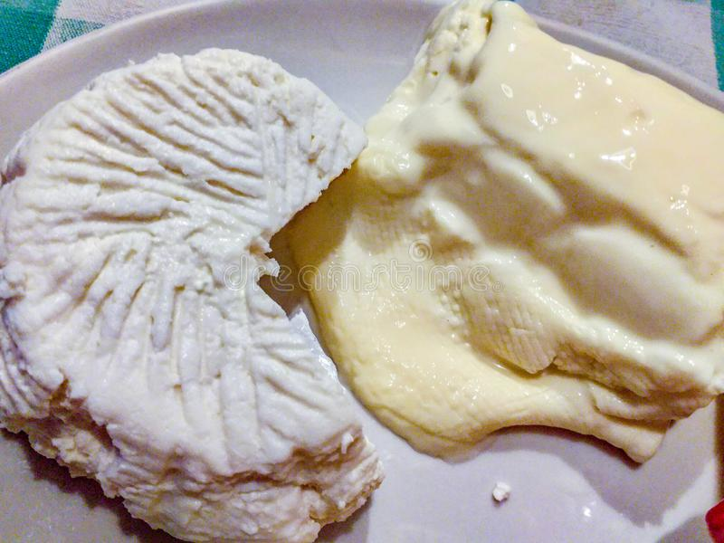 typical mountain cheeses. There are different types of cheese and always unique flavors. here you can see a mature cheese, a rico royalty free stock photo