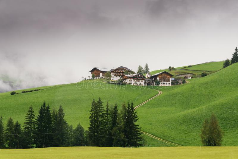 Typical mountain houses on a hill in Alto Adige / South Tyrol, Italy stock photography