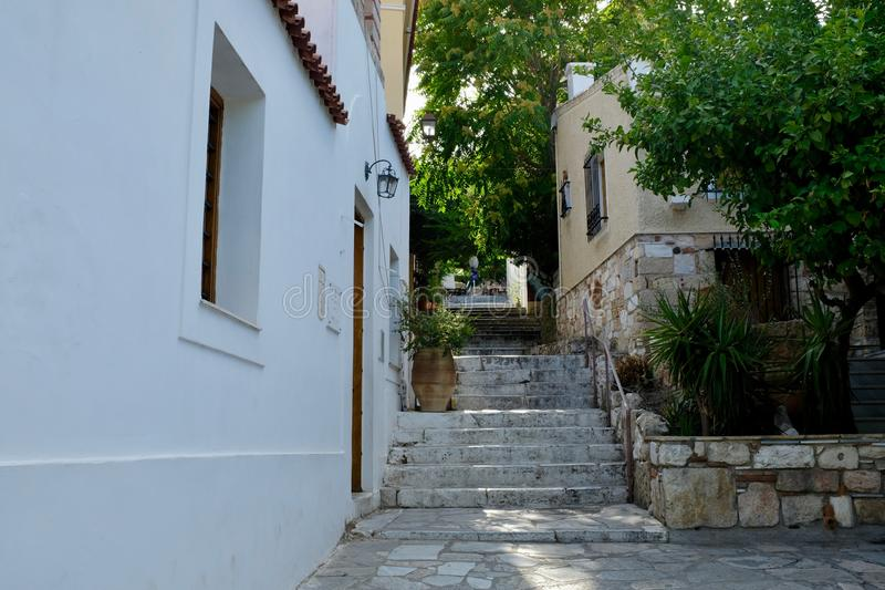 Narrow Passage and Marble Steps in Athens Alley. A typical narrow alley with stone sidewalk and walls, and marble steps in Athens, Greece stock images