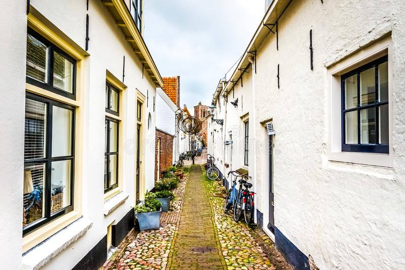 Narrow cobblestone streets in the village of Elburg in the heart of Holland royalty free stock image
