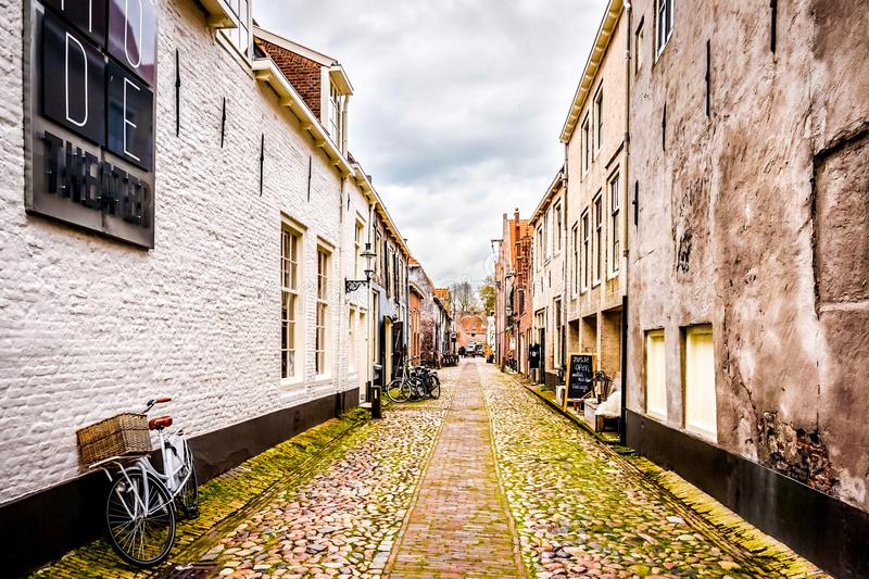 Narrow cobblestone streets in the village of Elburg in the heart of Holland royalty free stock photography