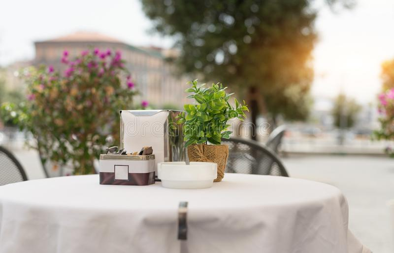 Typical Neapolitan bar table in city center. Typical Neapolitan bar table with chairs in the city center awaits visitors to have coffee royalty free stock photography
