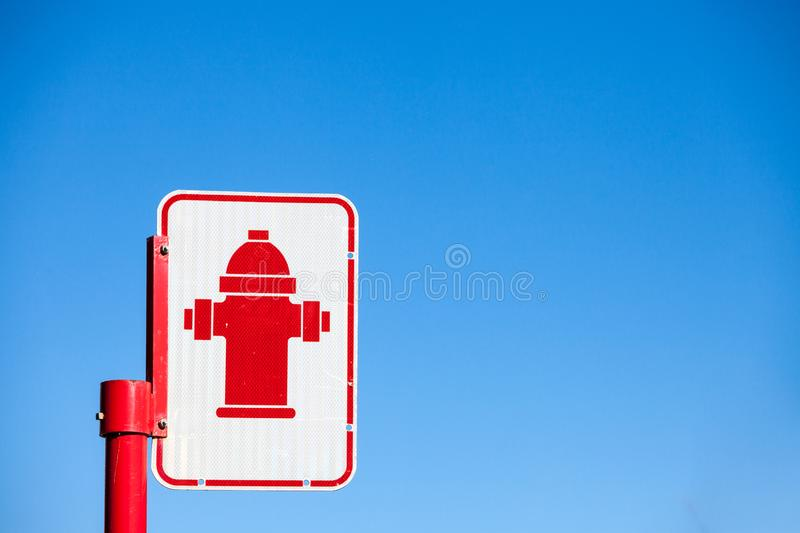 Typical North American road sign indicating the presence of a fire hydrant taken in a street of Montreal, Quebec, Canada. Picture of a fire hydrant street sign royalty free stock photography