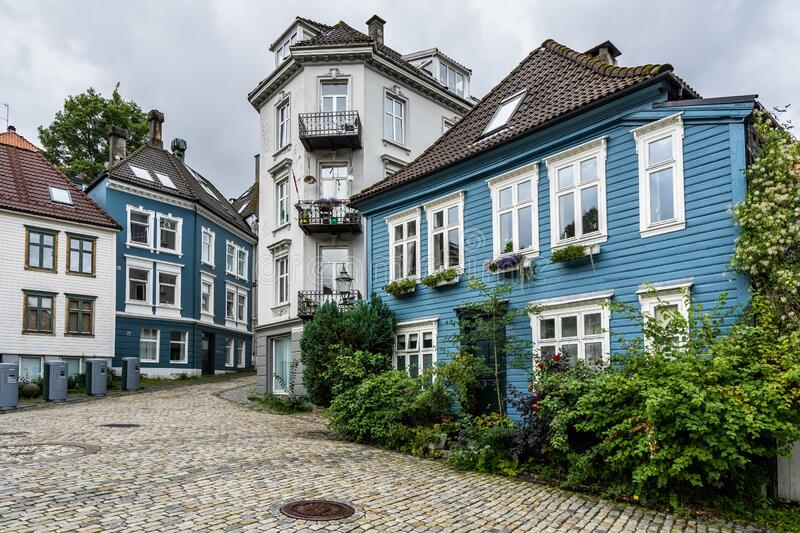 Typical Norwegian wooden houses in the street in Bergen, Norway. The typical Norwegian wooden houses in the street in Bergen, Norway stock photos