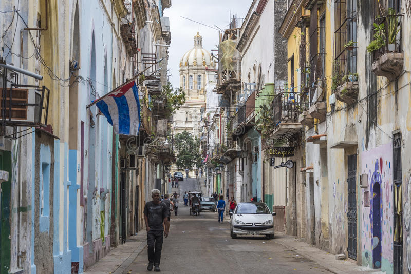 Typical Old Havana street with Capitol in the background royalty free stock photography