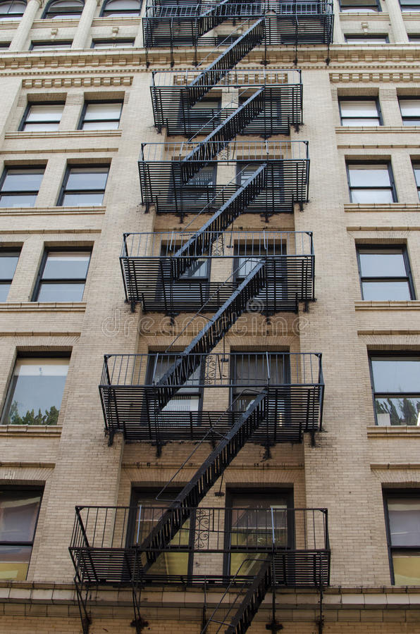 The typical old houses with fire stairs in Manhattan New York. In USA stock images