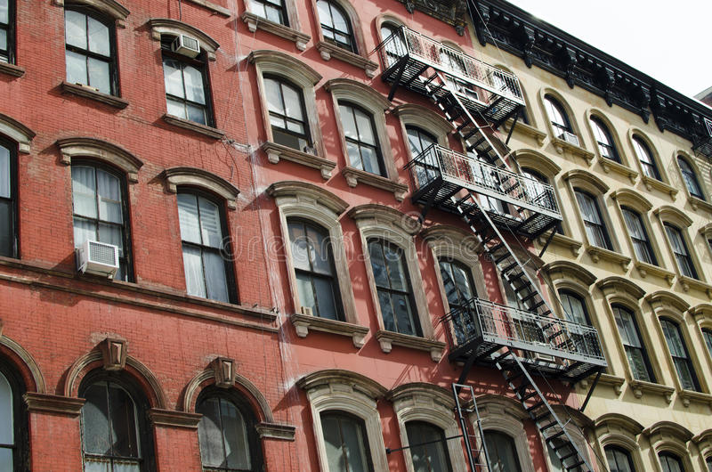 The typical old houses with fire stairs in Manhattan New York. In USA royalty free stock images