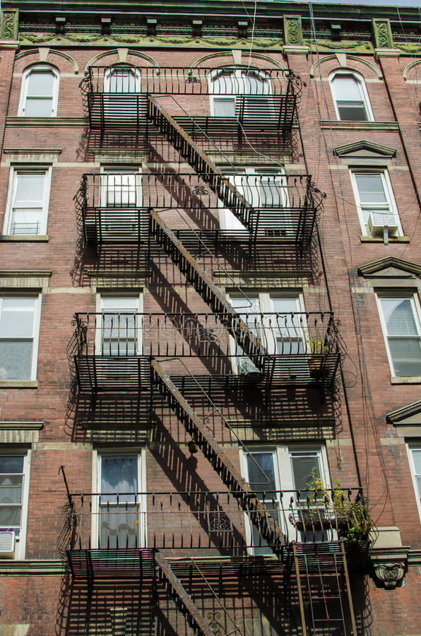 The typical old houses with fire stairs in Manhattan New York. In USA royalty free stock image