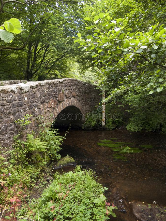 Picturesque Dartmoor. Typical old stone bridge over the River Bovey at North Bovey on the edge of Dartmoor National Park, Devon, UK royalty free stock image