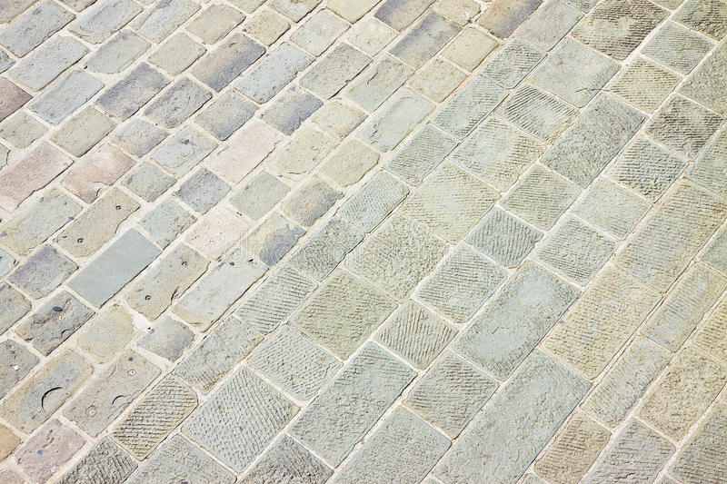 Typical old Tuscany paving made with carved stone blocks Italy.  royalty free stock photos