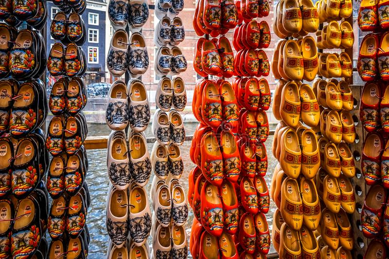 Typical painted wooden shoes in a Dutch souvenir shop in the old city center of Amsterdam royalty free stock images