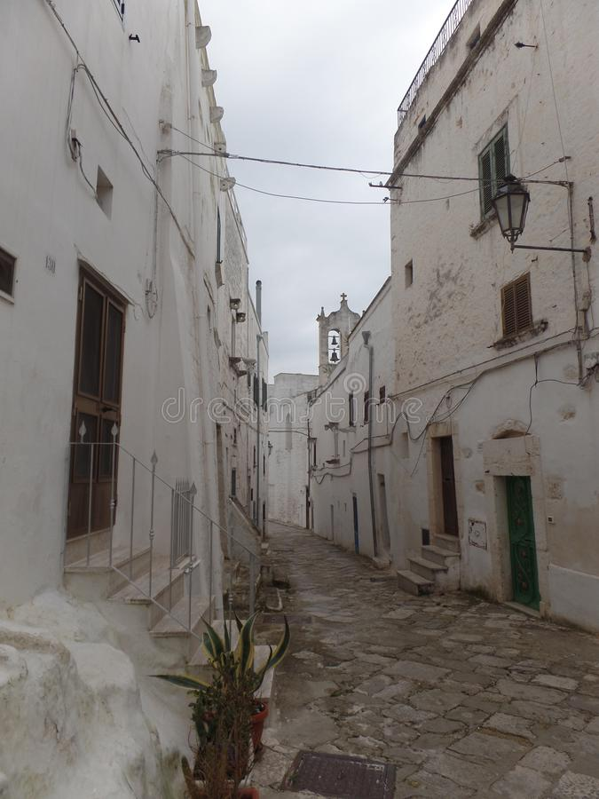Typical street of white washed houses in Ostuni, Puglia, Italy royalty free stock photo