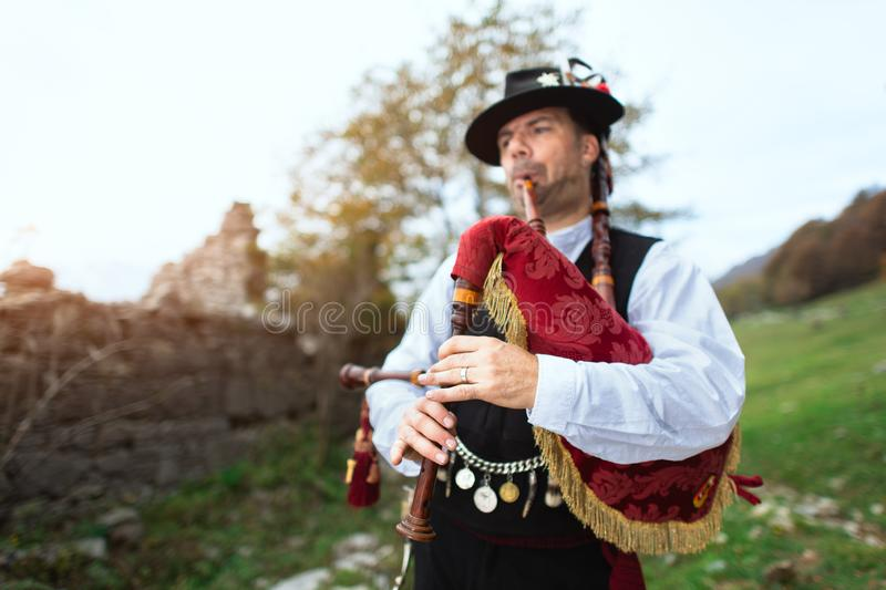 Typical player in traditional bergamo bagpipe from the alpine valleys of northern Italy.  royalty free stock photos