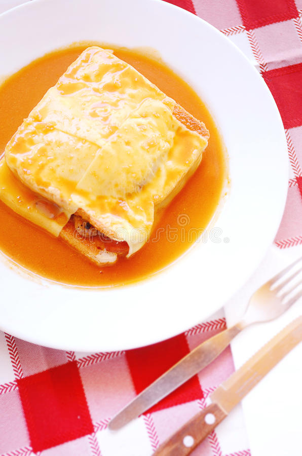 Typical Portugal food in Porto area: Francesinha. Francesinha is a Portuguese sandwich originally from Porto, made with bread, wet-cured ham, linguiça, fresh royalty free stock photography