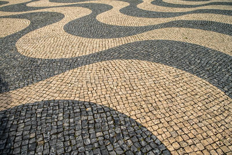 Typical portuguese cobblestone pavement pattern . black and whit royalty free stock photos