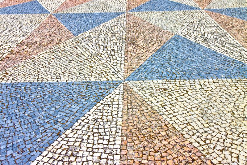 Typical Portuguese floor made of small pieces of colored stone.  stock photography
