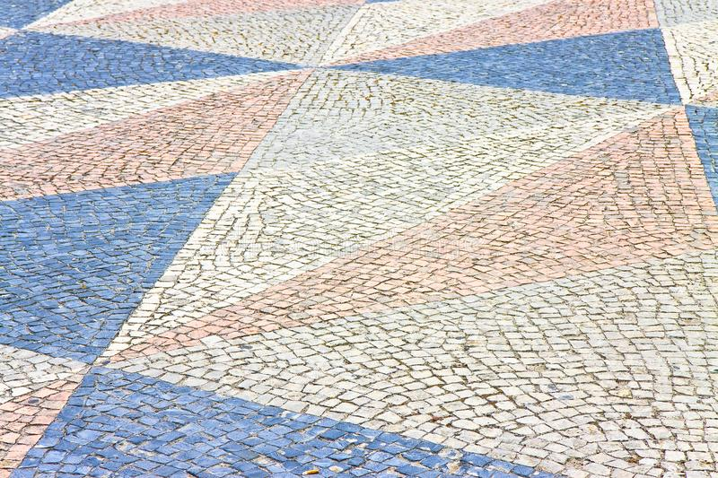 Typical Portuguese floor made of small pieces of colored stone.  royalty free stock photo