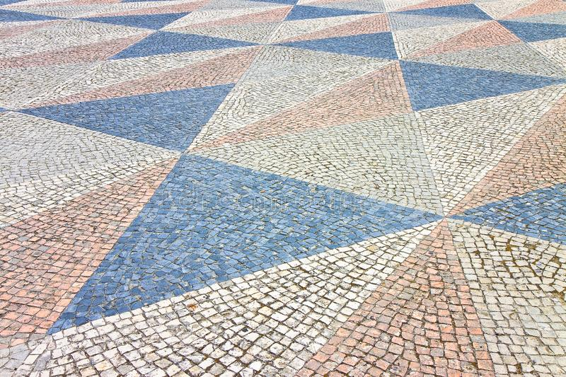 Typical Portuguese floor made of small pieces of colored stone.  stock photos