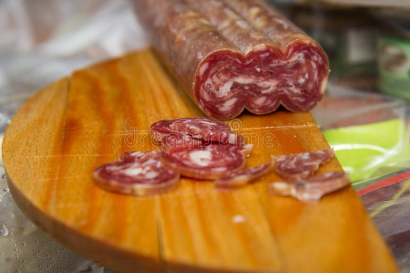 Salami is a type of cured sausage consisting of fermented and air-dried meat, typically beef or typical products of Emilia Romagna. Salami is a type of cured royalty free stock photography